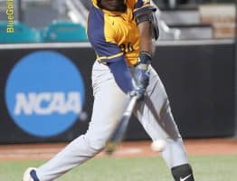 West Virginia catcher Paul McIntosh tries to square up on a pitch