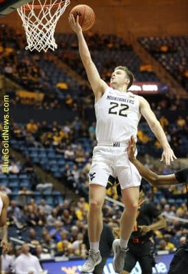 West Virginia guard Sean McNeil (22) soars to the hoop for a lay-up