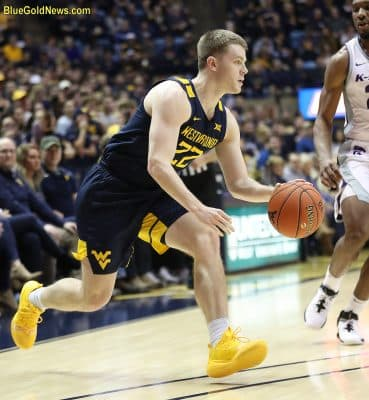 West Virginia guard Sean McNeil drives from the perimeter