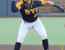 West Virginia catcher Vince Ippoliti signals to the dugout after an RBI hit