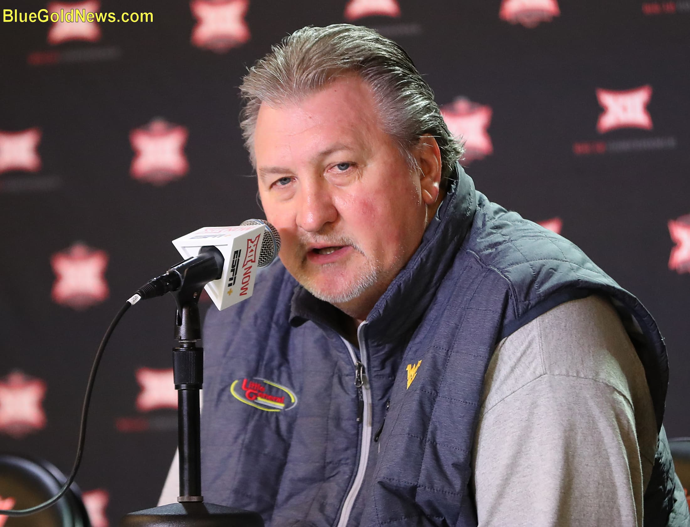 from the big 12 podium, west virginia head coach bob huggins takes up questions