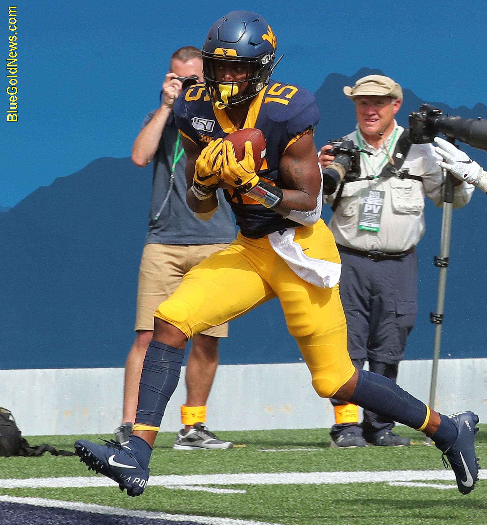 West Virginia wide receiver George Campbell cradles a touchdown pass against James Madison